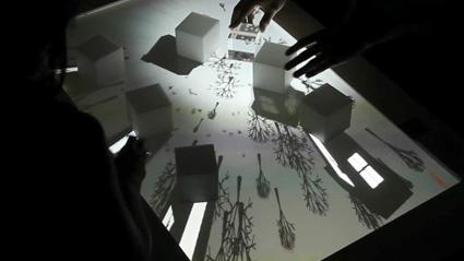 העולם הוירטואלי סביב קוביות שולחן ב-Augmented Shadow